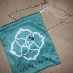 Kendra Scott necklace with iridescent stone.